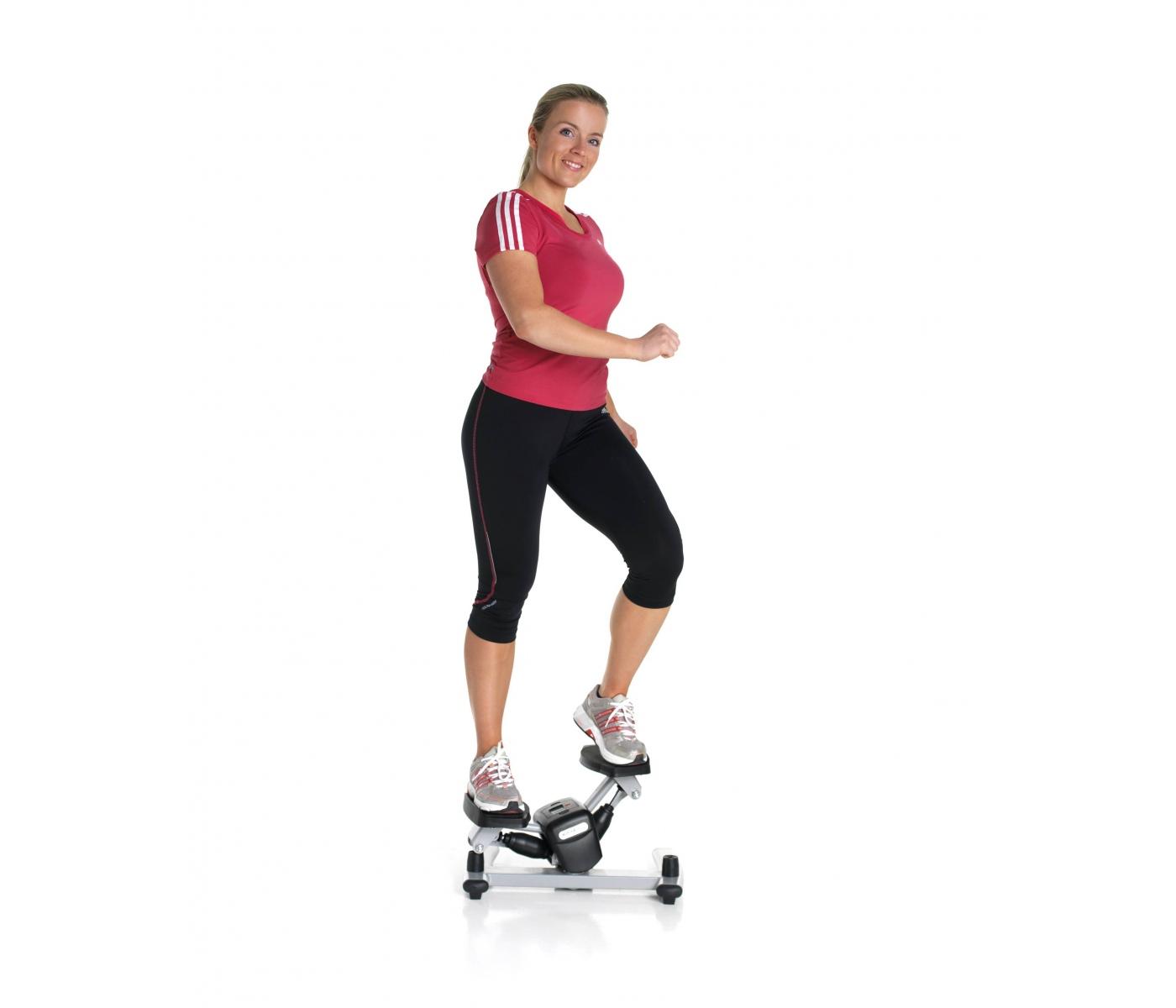 kvinde på stepmaskine